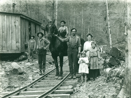 Young_family_in_lumber_camp_medium