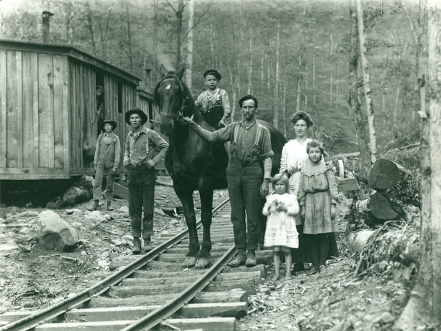 Young_family_in_lumber_camp_standard